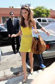 Cheryl carries a soft leather hobo bag around LA.