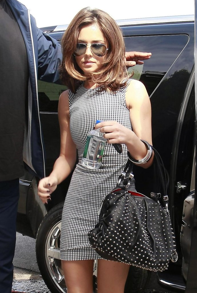 Sporting A Dangerous Looking Studded Bag Cheryl Cole Looked In Her Black And White