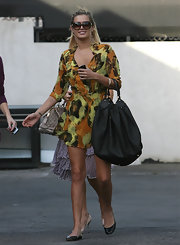 Model Cheyenne Tozzi is sporting this LV monogram leather black tote while arriving for a photoshoot in Hollywood.