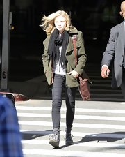 Chloe Moretz hit the airport in a military green pea coat and a thin black scarf.