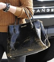 Chloe Grace Moretz sported a very distressed handbag while out in Hollywood.