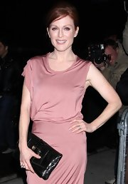 "Actress Julianne Moore showed off her blush tone dress while at the ""Chloe"" premiere. She topped her look off with a patent leather black clutch that was full of character."