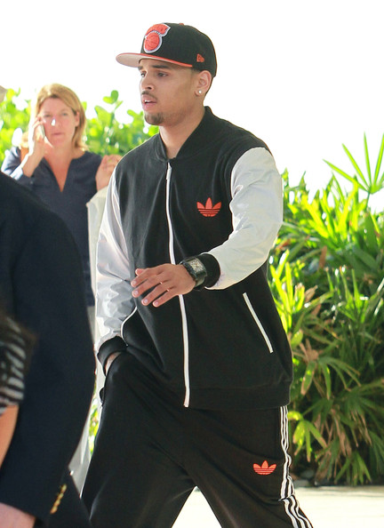 Chris Brown showcased another baseball cap from his extensive collection as he took a phone call outside his hotel in Miami.