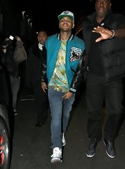 Chris Brown was photographed exiting a club wearing a teal track jacket with the San Jose Sharks logo.
