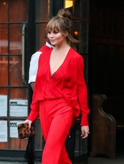 Chrissy Teigen teamed a leopard-print clutch with chic red separates for a day out in New York City.