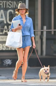 Chrissy Teigen looked super cool in a Splendid denim romper while out walking her dog.