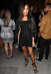 Ashley Madekwe styled her leggy look with a pair of black crisscross-strap sandals.