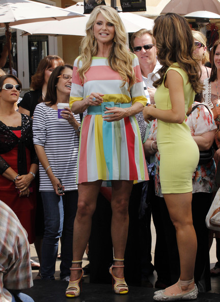 Christie Brinkley paired her striped summery dress with cool multi-colored heeled sandals with double ankle straps.