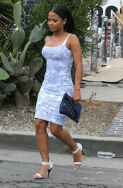 Christina Milian finished off her ensemble with a blue biker clutch.