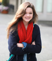 Ciara Bravo brightened up her ensemble with a red knit scarf.