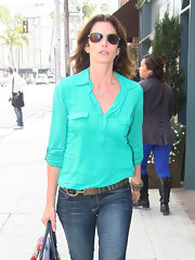 Cindy Crawford brightened her casual winter ensemble with this aqua collared shirt while out in Beverly Hills.