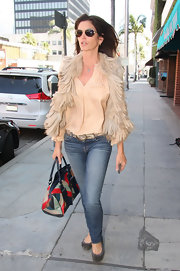 Cindy Crawford looked effortlessly elegant in a silky peach blouse.
