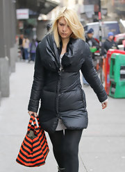 Claire Danes spiced up her dark winter wear with a playful striped tote.