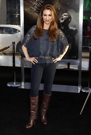 Actress Alyssa Milano came out looking more casual than usual in this frumpy lace top and blue jeans. She completed her look with a pair of brown leather boots.