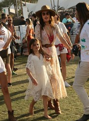 Alessandra Ambrosio looked adorable twinning with her daughter in matching white lace dresses during Coachella 2017.