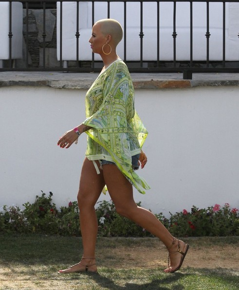 Amber Rose in a Lime Tunic