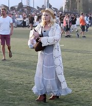 Hayley Hasselhoff chose a retro hippie look at Coachella with this pale blue prairie-style dress.