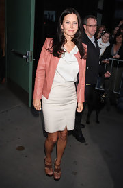 Courteney Cox teamed her ladylike khaki shift with cognac leather platform sandals.
