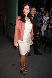 Courteney Cox wore a pink leather jacket over her demure pencil dress.