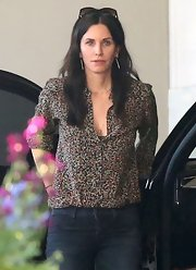 Courteney Cox kept her look casual but cute with this floral print blouse.