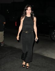 Courteney Cox opted for a sleeveless black dress and belt while out celebrating her birthday.
