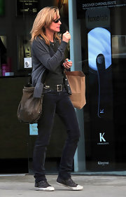 Courtney Thorne-Smith paired a casual look with buckled gray canvas sneakers.