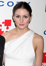 Olivia Palermo showed off her classic bun with a sleek center part. It was a nice complement to her feathered frock.