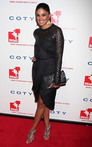 Designer Rachel Roy showed off her edgy side in this beaded satin dress. She paired her look with a stunning studded clutch.