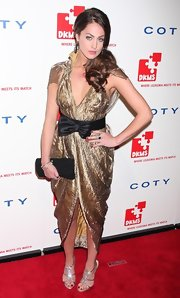 """The City"" cast mate Roxy Olin showed off her style while hitting this NYC red carpet. The gold bow embellished dress was not our favorite, but was a nice upgrade for the reality star."