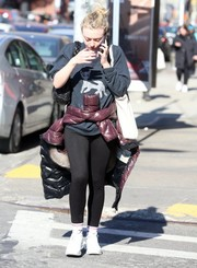 Dakota Fanning was seen out in New York City looking relaxed in a cat-print sweatshirt by Unfortunate Portrait.