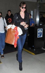 Dakota Johnson was spotted at LAX looking rocker-chic in a black leather jacket.