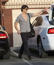 Gleb Savchenko stopped by 'Dancing With the Stars' rehearsals wearing a casual gray cardigan.