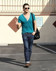 Gleb Savchenko looked bright and stylish in a teal v-neck tee at the 'Dancing with the Stars' rehearsals.