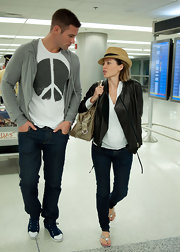 Kris wears a peace t-shirt to the airport with Danni.