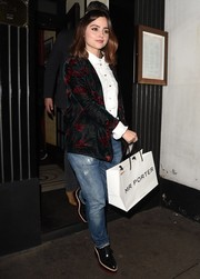 Jenna-Louise Coleman attended David Beckham's fashion brand launch wearing a printed blazer over a ruffle blouse.