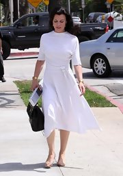 Debi dons a vintage inspired white day dress with a tie belt for a day out in Beverly Hills.