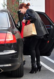 "Debra Messing stays stylish in these ""Lace Up Ankle Boots"", while out in Brentwood on a day of shopping. These lace up boots are very on trend and add a flash of edge to her all black get up."
