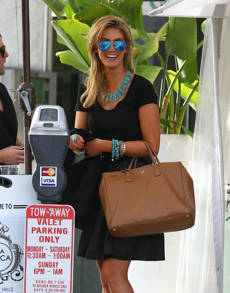Delta Goodrem was in the mood for blue accessories, wearing a spiked statement necklace with beaded bracelets in addition to her cool aviators.