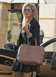 Delta Goodrem was out and about in Beverly Hills carrying a stylish tan Prada tote.