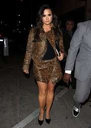 Demi Lovato headed to Catch looking fierce in a leopard-print pony-skin jacket and skirt combo by Isabel Marant.