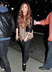 Demi Lovato kept her street style dark with a pair of tight black skinny jeans.