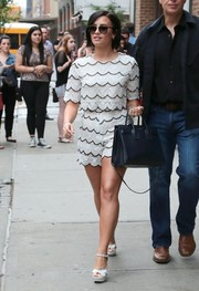 A sweet-looking Demi Lovato stepped out in New York wearing a scalloped lace crop-top by Sister Jane.