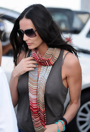 Demi Moore looked chic in a pair of oversized gray and black sunglasses.