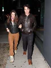 Dermot Mulroney chose a basic brown bomber jacket to wear to a dinner with his wife.