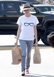 Diane Kruger chose a basic tee with a fun glasses design for her quirky look while out running errands.