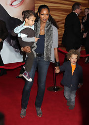Garcelle Beauvais is one chic mom! Her gray suede ankle boots show off a red hot pedi.