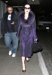 Dita Von Teese travels in style carrying her glimmering Dolce & Gabbana Miss Sicily East/West Tote. The black sequin tote is the perfect ladylike bag for the Burlesque queen.