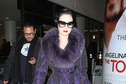 Model Dita Von Teese arrives at LAX airport in Los Angeles.