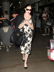 Dita was spotted arriving at LAX airport where she toted a large leather tote bag.