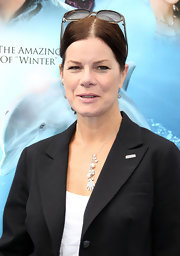 Marcia Gay Harden showed up at the 'Dolphin Tale' premiere wearing another beautiful casual necklace -- a silver chain with multiple charm pendants.